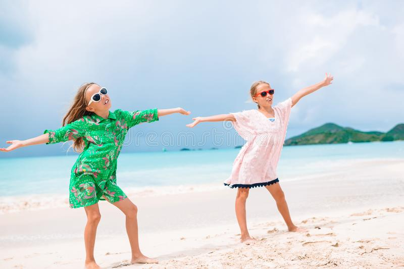Kids have a lot of fun at tropical beach playing together royalty free stock image