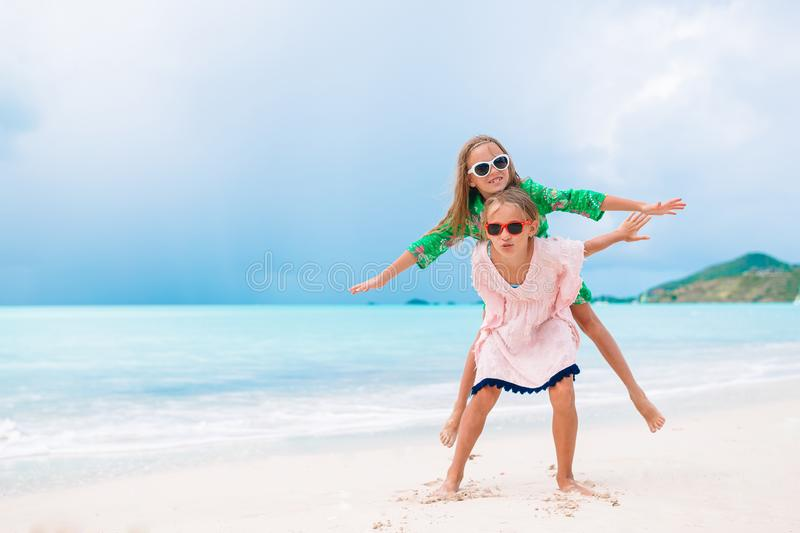 Kids have a lot of fun at tropical beach playing together stock images