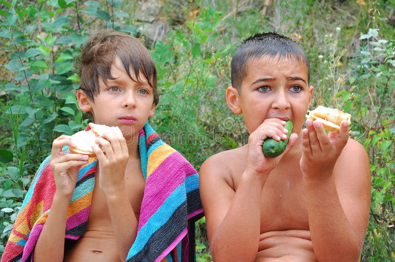 Kids having dinner outdoor stock image