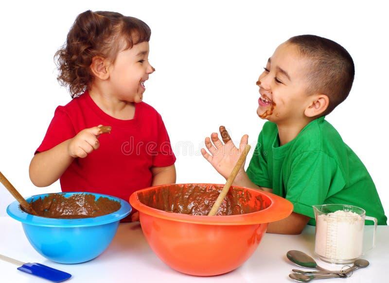 Kids having fun baking stock photography