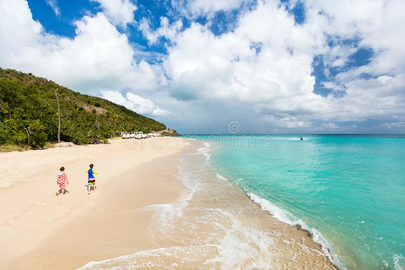 Kids having fun at beach. Kids brother and sister walking at tropical beach during Caribbean summer vacation stock image