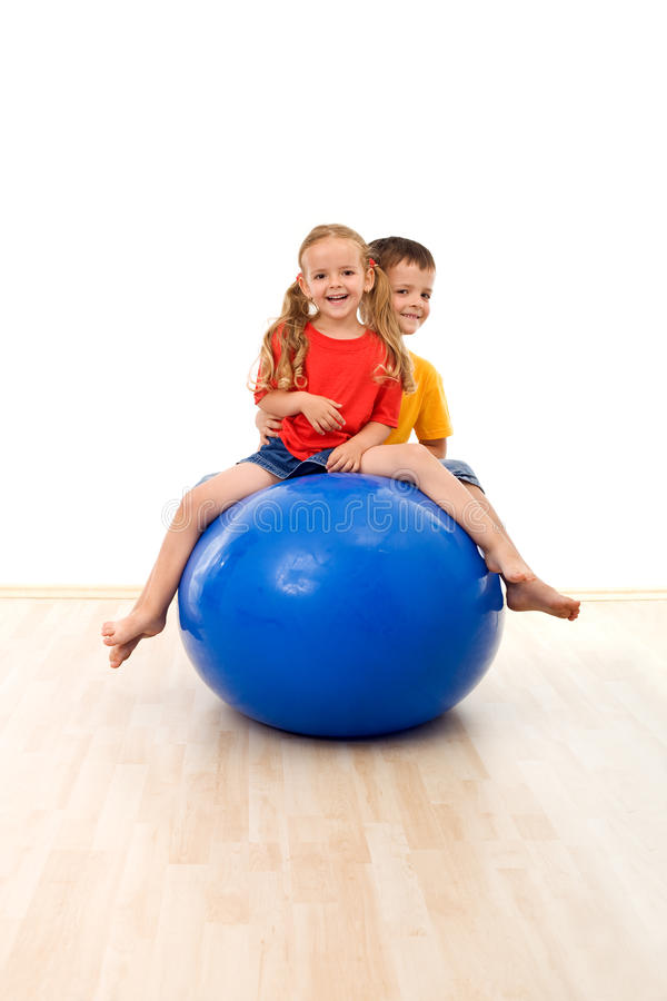 Download Kids Having Fun And Exercises With A Large Ball Stock Photo - Image: 14825490
