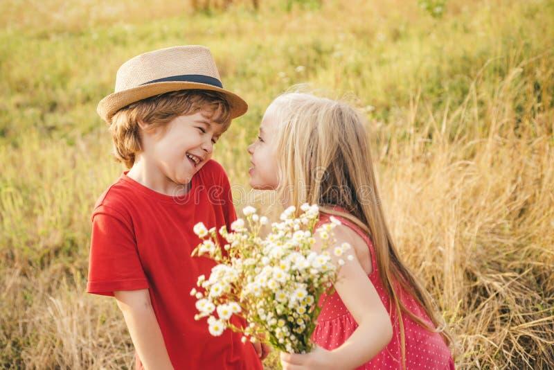 Kids having fun in field against nature background. Valentine. Sweet angel children. Valentines day cupid child stock photos