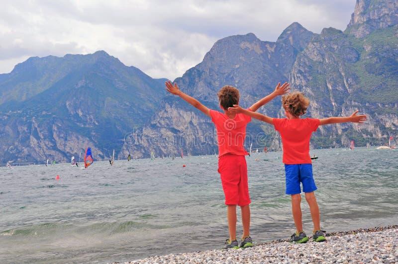 Download Kids having fun stock photo. Image of beach, garda, mountains - 41868562