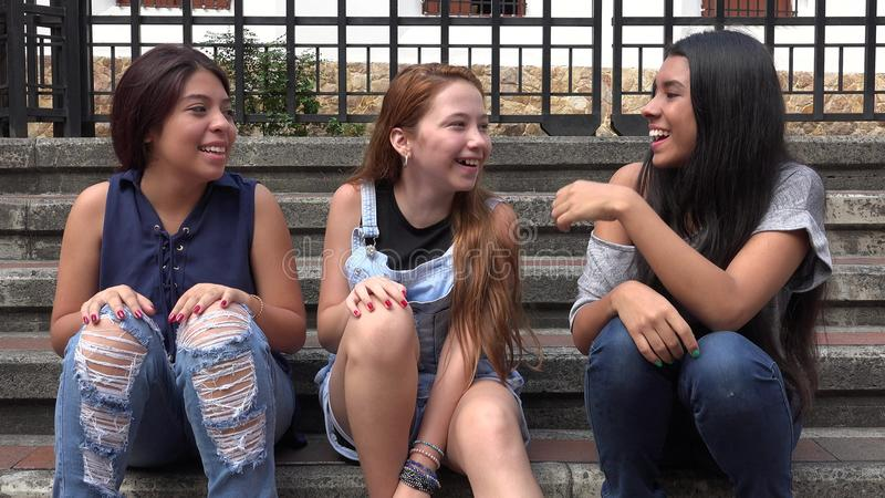 Kids Having Fun Happy Teens. Group of Happy Teens Girls Sitting Together stock photography
