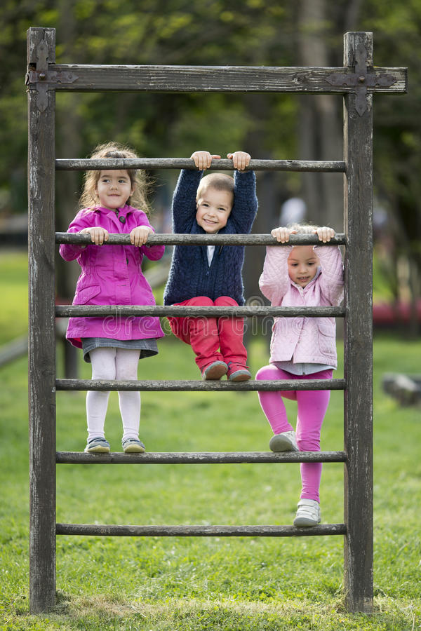Kids having fun. At playground royalty free stock photo