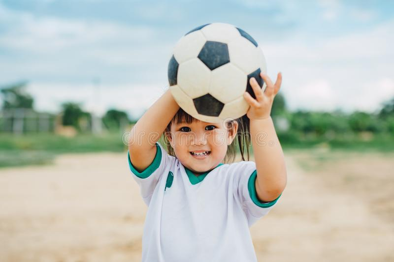 Kids playing soccer football. stock images