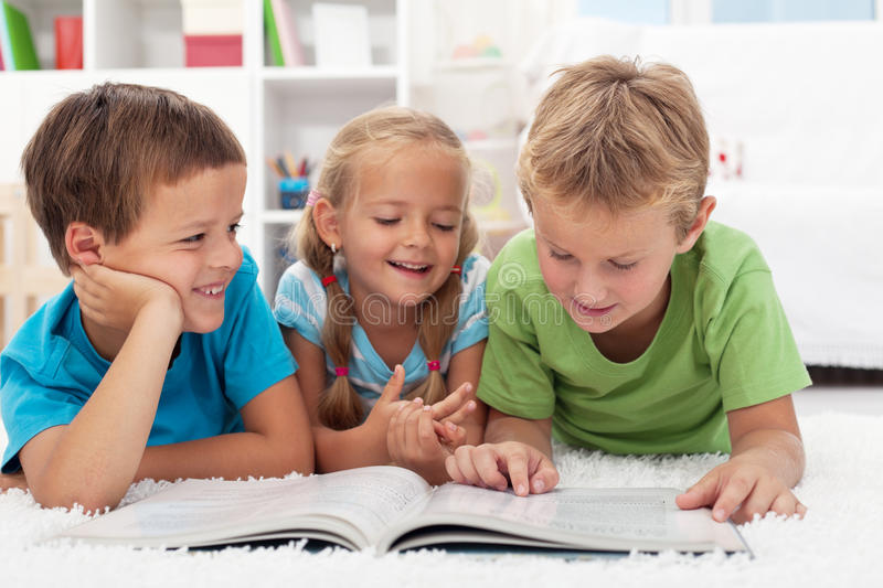 Kids having fun reading stock photo