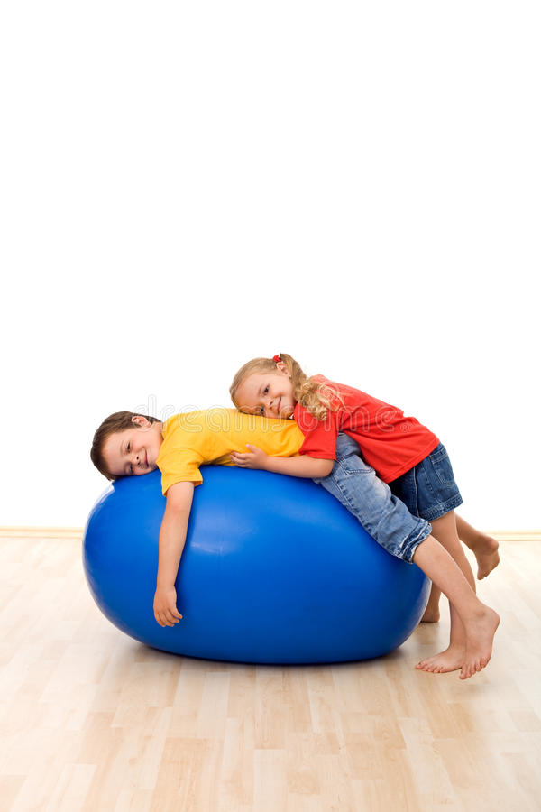 Free Kids Having Fun Relaxing On A Large Rubber Ball Royalty Free Stock Images - 14825609