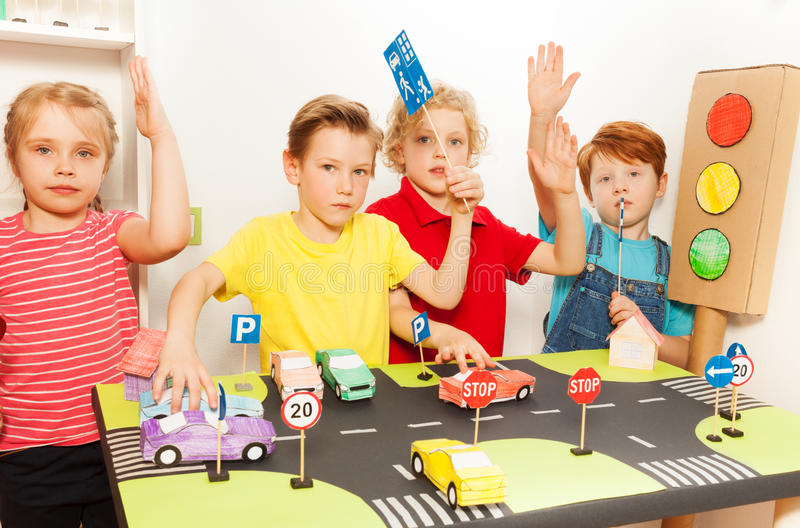 Kids having fun studying traffic or highway code royalty free stock photography