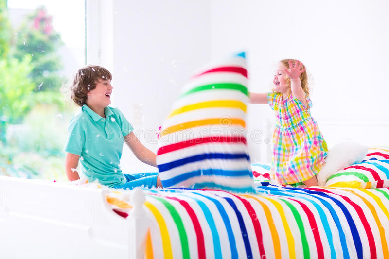 Download Kids Having Pillow Fight Stock Photo Image Of Furniture