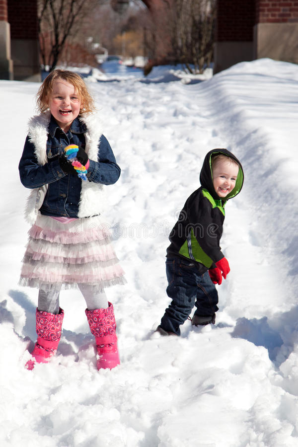 Kids having a snowball fight stock photography
