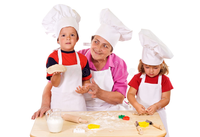 Kids having some fun. Kids with grandmother preparing cookies - isolated stock images