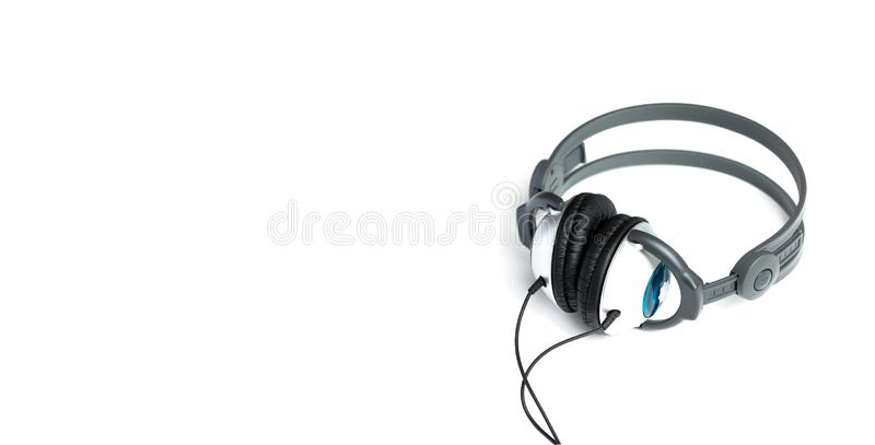 Kids headphones in gray and black on white background. learning foreign languages. Panoramic. stock image