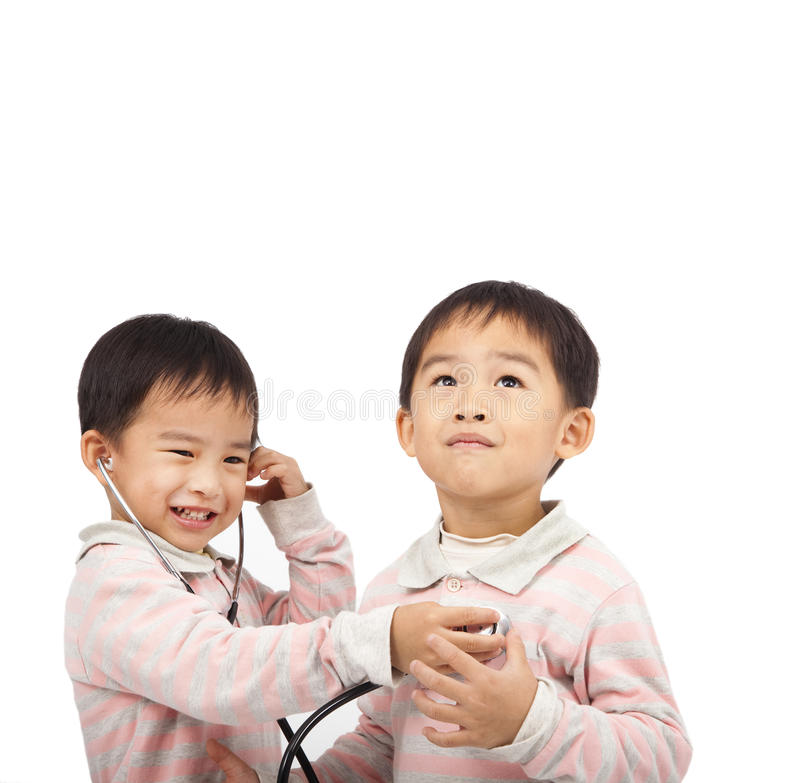 Kids with health examination by stethoscope. Two kids with health examination by stethoscope royalty free stock photography