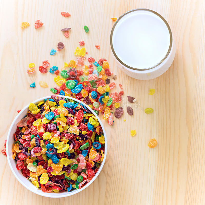 Kids healthy quick breakfast. Colorful rice cereal with milk on. Wooden background. Copy space. Selective focus. Square image stock images