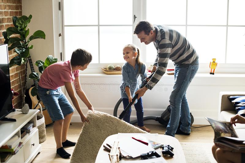 Kids helping the house chores stock photos