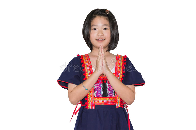 Kids in hill tribe costume, welcome pose, Thai style sawadee. Kid in hill tribe costume, welcome pose, Thai style sawadee on white royalty free stock photos