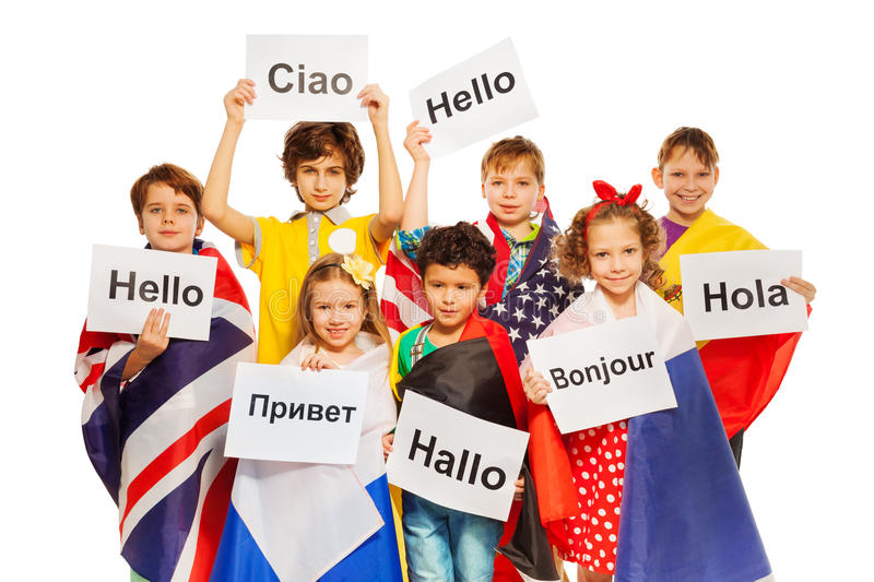 Kids holding greeting signs in different languages royalty free stock image