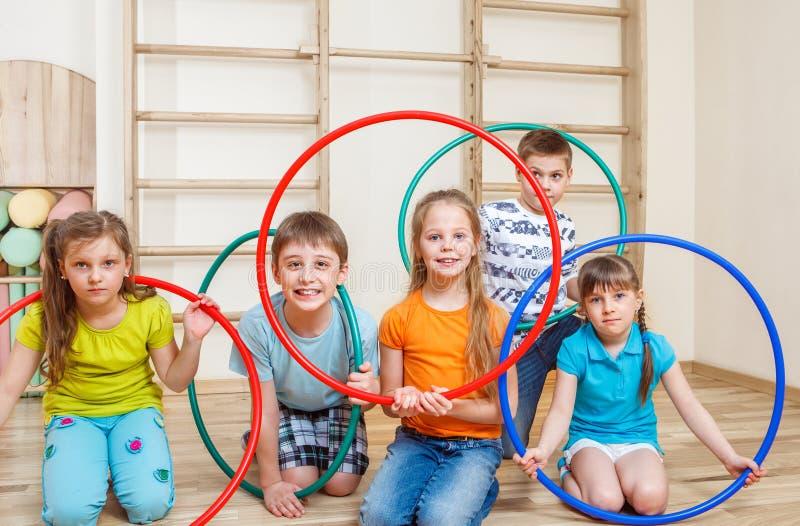Kids holding hula hoops stock photo