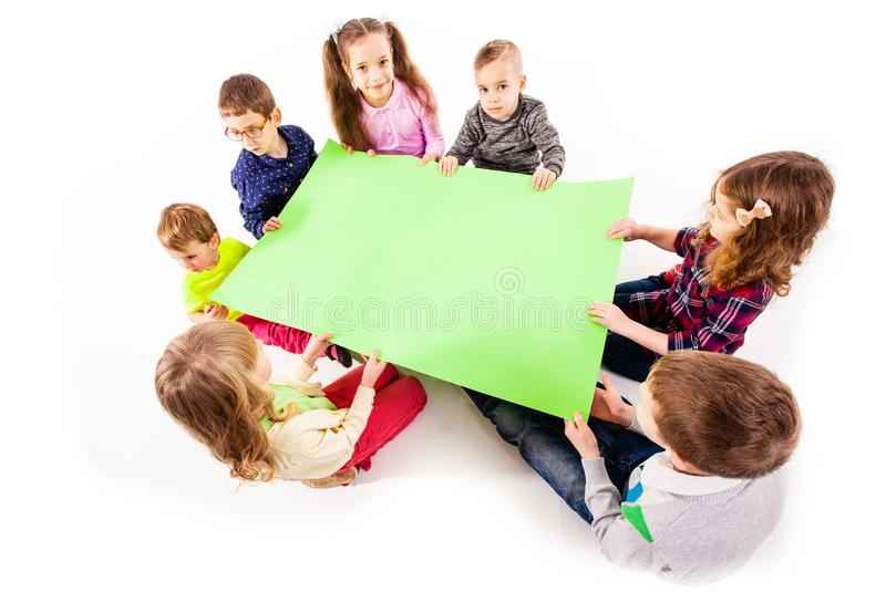 The kids are holding a white blank royalty free stock images