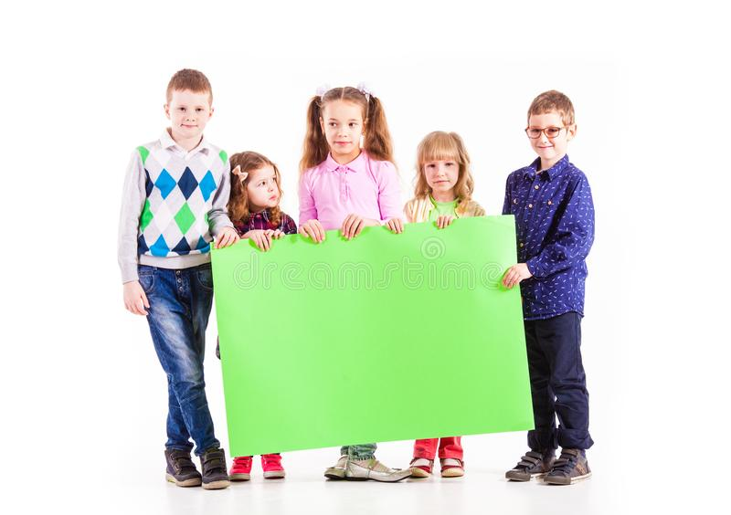 The kids are holding a white blank royalty free stock photography