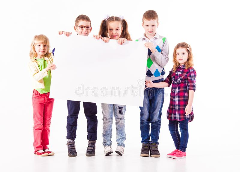 The kids are holding a white blank stock images