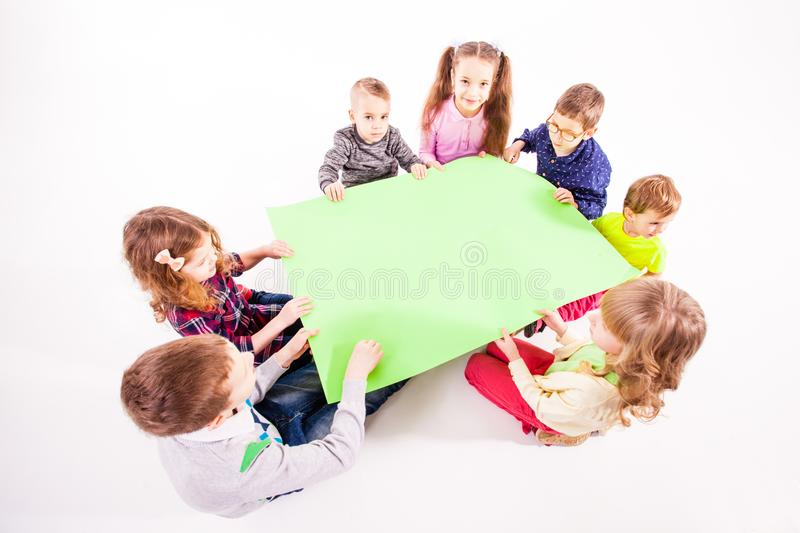 The kids are holding a white blank stock image