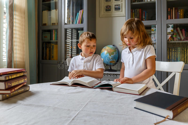 Kids at homework. At home stock photography
