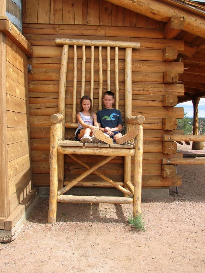 Kids in Huge Chair royalty free stock photos