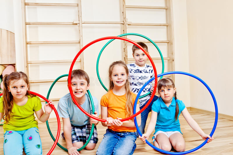 Kids with hula hoops. Kids group with colorful hula hoops royalty free stock image