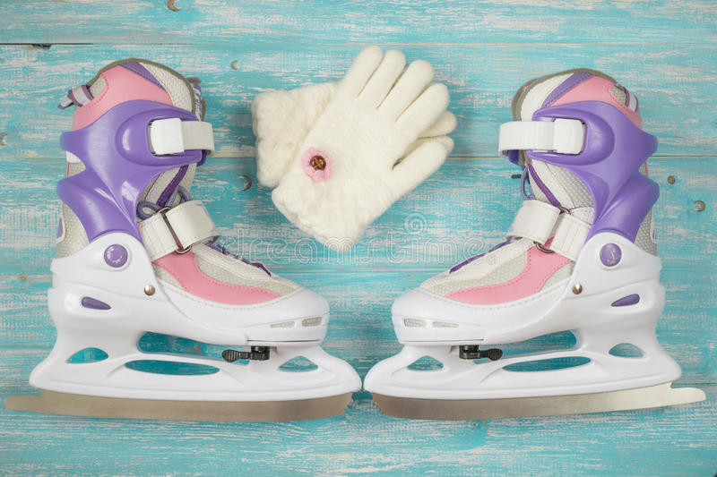 Kids ice skates with adjustable size and accessories on the wooden floor. stock images