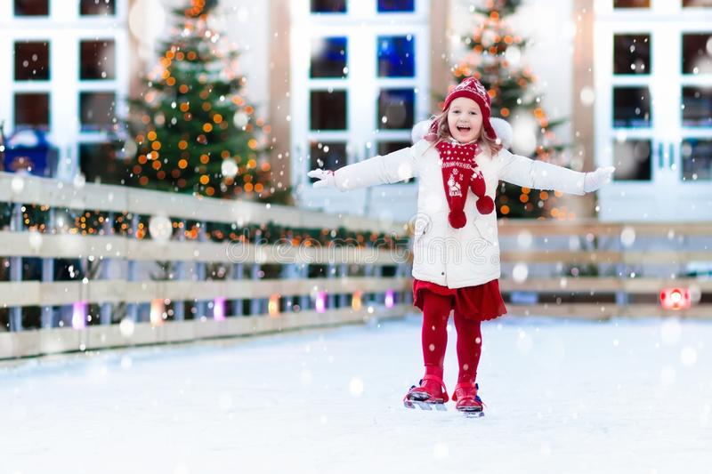 Kids ice skating in winter. Ice skates for child. royalty free stock images