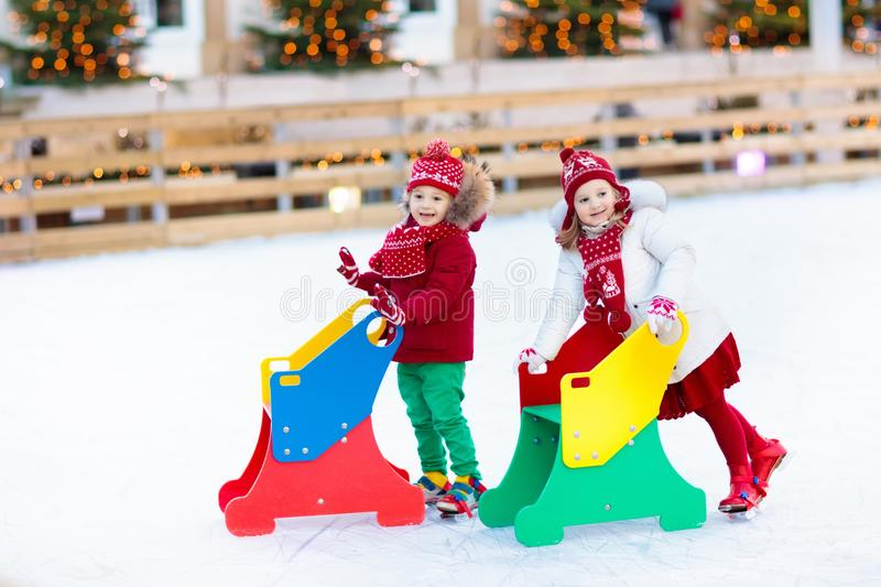 Kids ice skating in winter. Ice skates for child. stock photos