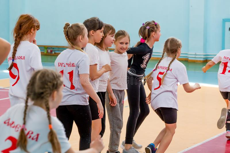 Kids indoors training before handball competition. Sports and physical activity. Training and. Russia, Vladivostok, 04/28/2018. Kids indoors training before royalty free stock photo
