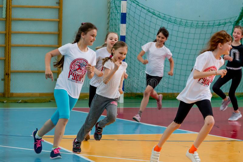 Kids indoors training before handball competition. Sports and physical activity. Training and. Russia, Vladivostok, 04/28/2018. Kids indoors training before stock photography