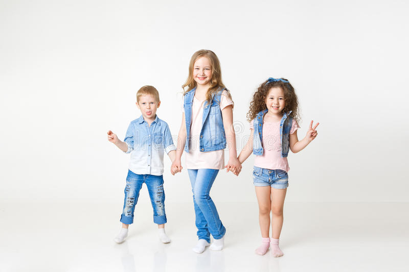 Kids in jeans clothes posing in studio. Copy-space royalty free stock photography