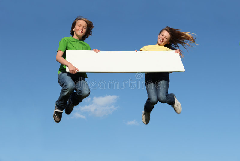 Kids Jumping With Blank Sign Royalty Free Stock Photo