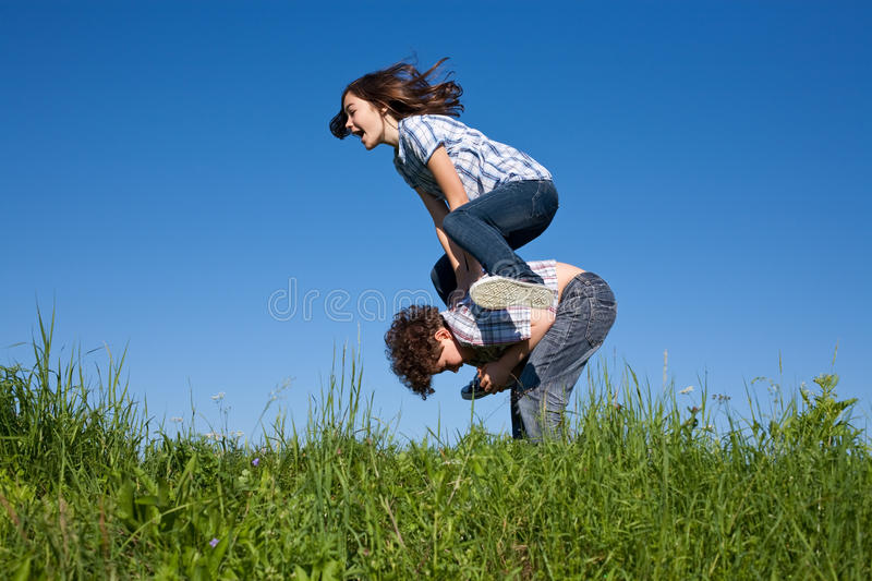 Kids Jumping Outdoor Royalty Free Stock Images