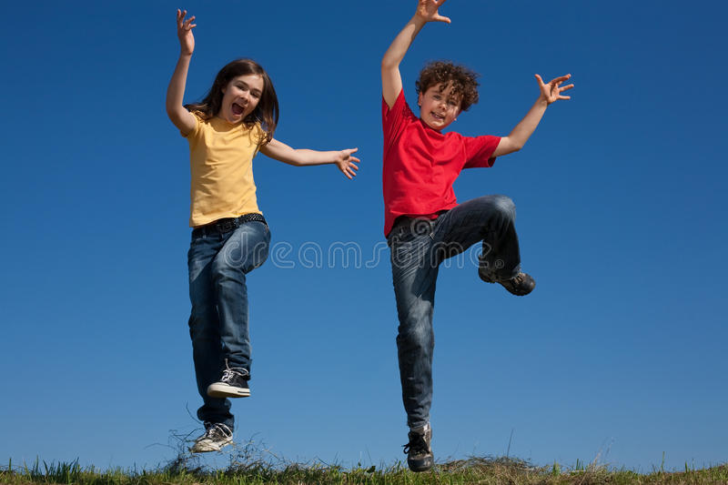 Download Kids jumping outdoor stock image. Image of girl, jumping - 10950411