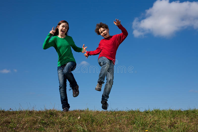 Download Kids Jumping Outdoor Stock Photography - Image: 14734122