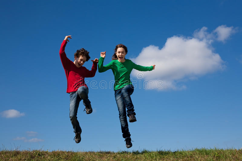 Download Kids jumping outdoor stock photo. Image of friends, enjoyment - 14734124