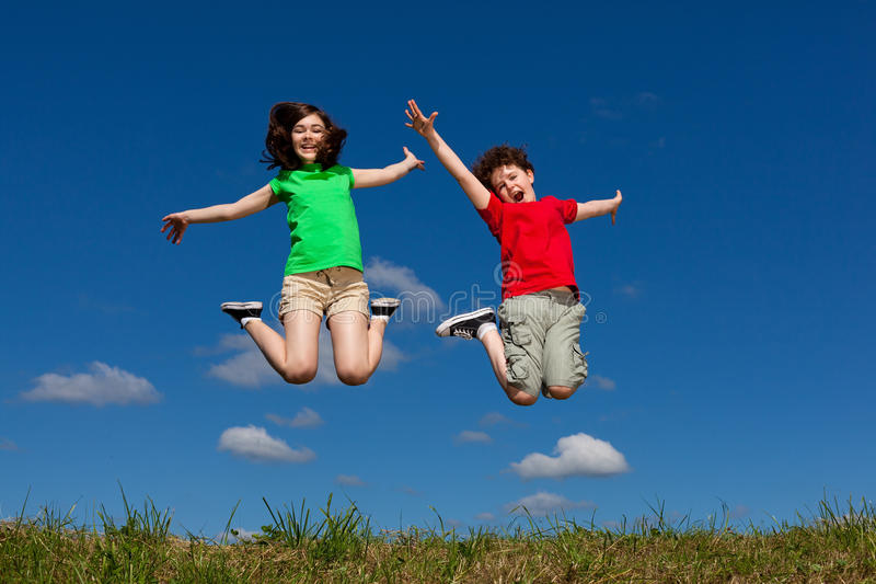 Download Kids jumping outdoor stock photo. Image of freedom, energy - 16190410