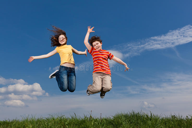 Download Kids jumping outdoor stock image. Image of jump, jogging - 16450617