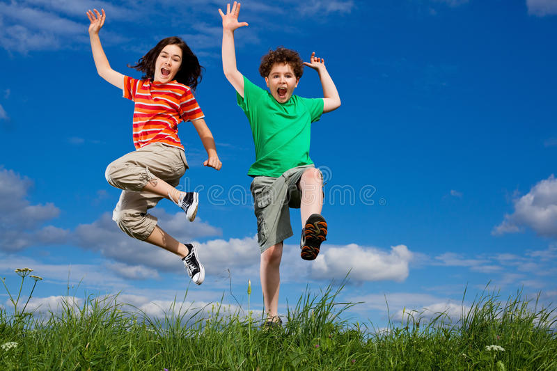 Download Kids jumping outdoor stock image. Image of action, friends - 17774979