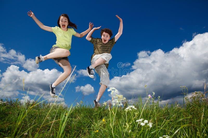 Download Kids jumping outdoor stock image. Image of joyful, girl - 20522419