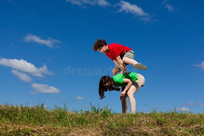 Download Kids jumping outdoor stock image. Image of children, enjoyment - 23514699