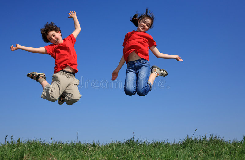 Download Kids jumping outdoor stock photo. Image of cloud, grass - 9088816