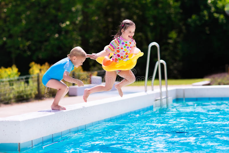 Kids Jumping Into Swimming Pool Stock Photo Image Of Outdoor Baby 74823578