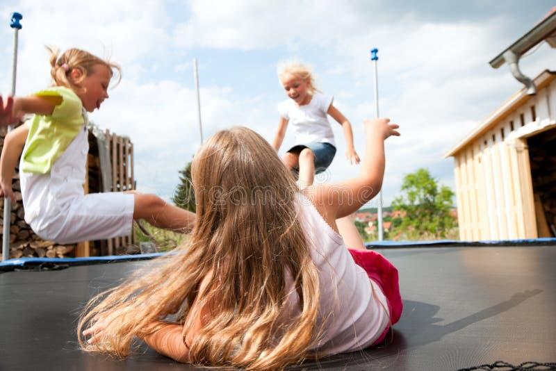 Kids Jumping On Trampoline Stock Image